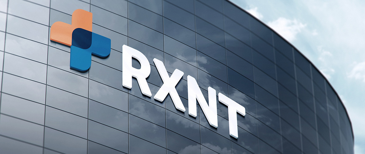 RXNT Logo and name displayed on a building outside
